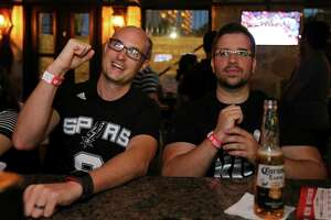Spurs fans Sammy Cartwright (left) and Anthony Tomic, from Canberra, Australia, watch the Spurs Clippers game Saturday May 2, 2015 at On The Rocks Pub.
