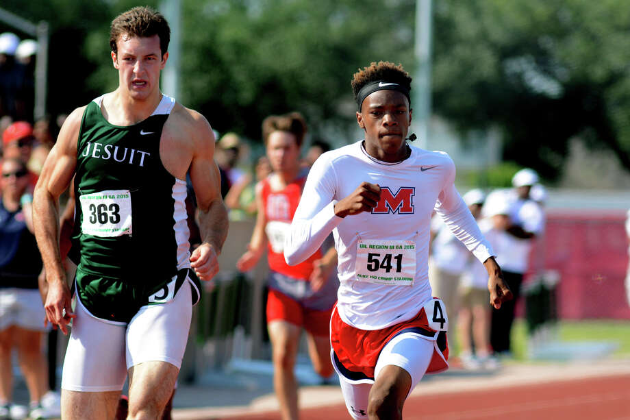 Manvel sophomore Howard Fields (541) pushes to the finish line with Strake Jesuit junior Christian McStravick (363) during the Boys 400 Meter Dash in the running finals of the 2015 Region III-6A Track & Field Championship at Crump Stadium in Alief on Saturday, May 2, 2015. Photo: Jerry Baker, Freelance