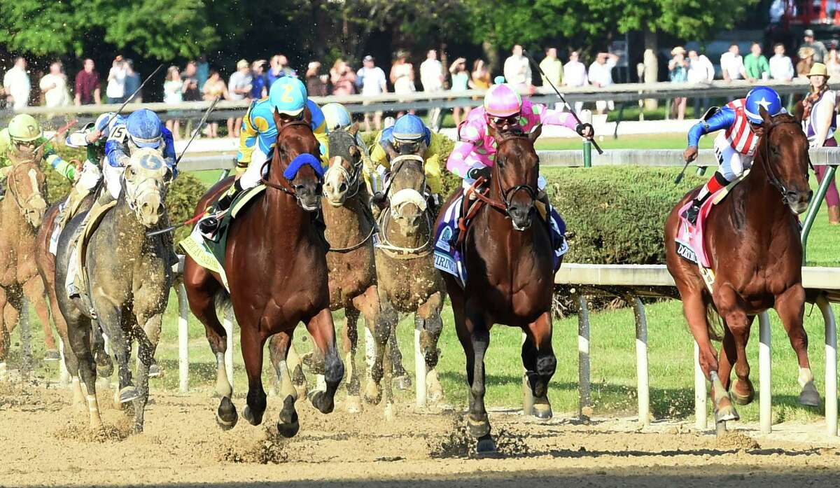 American Pharaoh, left, with jockey Victor Espinoza in the irons wins the 141st Kentucky Derby May 2, 2015 at Churchill Downs in Louisville, Kent. The thoroughbred, only the 12th Triple Crown winner in history, was elected to National Museum of Racing and Hall of Fame on Wednesday. (Skip Dickstein/Times Union)