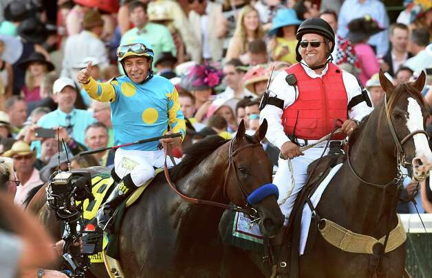 Jockey Victor Espinoza is jubilant after winning the 141st Kentucky Derby May 2, 2015 at Churchill Downs in Louisville, Kentucky.      (Skip Dickstein/Times Union) Photo: SKIP DICKSTEIN