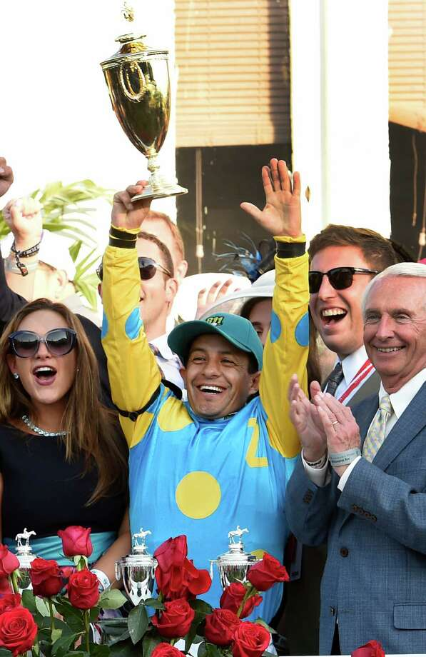 Jockey Victor Espinoza holds the winner's trophy aloft after winning  the 141st Kentucky Derby on American Pharaoh  May 2, 2015 at Churchill Downs in Louisville, Kentucky.      (Skip Dickstein/Times Union) Photo: SKIP DICKSTEIN
