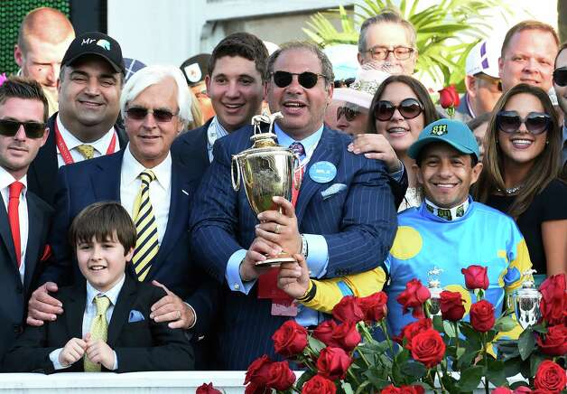 Owner Ahmed Zayet holds the winner's trophy and is joined in the winner's circle with trainer Bob Baffer left and jockey Victor Espinoza, right after winning  the 141st Kentucky Derby on American Pharaoh  May 2, 2015 at Churchill Downs in Louisville, Kentucky.      (Skip Dickstein/Times Union) Photo: SKIP DICKSTEIN