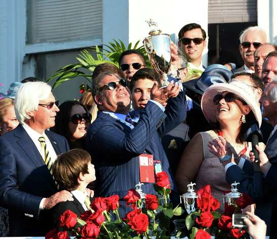 Owner Ahmed Zayat holds the winner's trophy aloft after his horse American Pharaoh won the 141st Kentucky Derby  May 2, 2015 at Churchill Downs in Louisville, Kentucky.      (Skip Dickstein/Times Union) Photo: SKIP DICKSTEIN