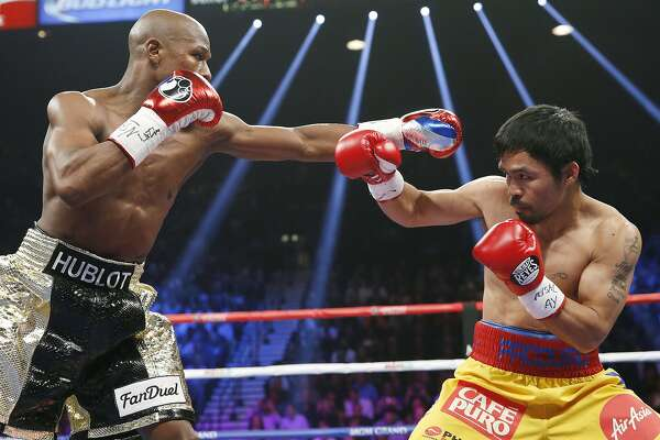 Floyd Mayweather Jr., left, squares off against Manny Pacquiao, from the Philippines, during their welterweight title fight on Saturday, May 2, 2015 in Las Vegas. (AP Photo/John Locher)