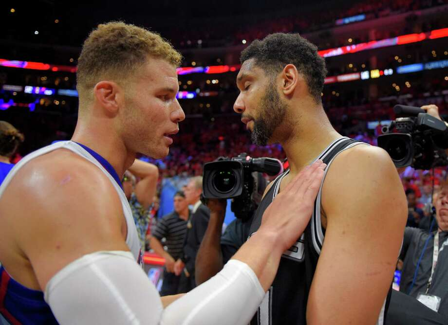 Los Angeles Clippers forward Blake Griffin, left, talks with San Antonio Spurs forward Tim Duncan after Game 7 in a first-round NBA basketball playoff series, Saturday, May 2, 2015, in Los Angeles. The Clippers won 111-109. (AP Photo/Mark J. Terrill) Photo: Mark J. Terrill, STF / Associated Press / AP