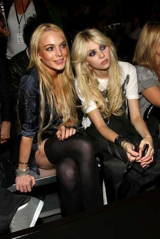 NEW YORK - SEPTEMBER 15:  Actresses Lindsay Lohan and Taylor Momsen attend the G Star Spring 2010 fashion show at Hammerstein Ballroom on September 15, 2009 in New York, New York.  (Photo by Jason Kempin/Getty Images ) *** Local Caption *** Lindsay Lohan;Taylor Momsen Photo: Jason Kempin, Getty Images / 2009 Getty Images