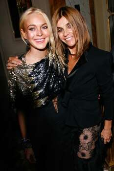 PARIS - OCTOBER 01: Lindsay Lohan (L) and Karine Roitfeld attend the 90 years of Vogue covers at Hotel Crillon on October 1, 2009 in Paris, France. (Photo by Julien M. Hekimian/Getty Images) *** Local Caption *** Lindsay Lohan;Karine Roitfeld Photo: Julien M. Hekimian, Getty Images / 2009 Getty Images