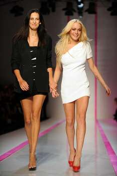 PARIS, FRANCE - OCTOBER 04:  Lindsay Lohan (R) and Estrella Archs walk the runway during the Emmanuel Ungaro Pret a Porter show as part of the Paris Womenswear Fashion Week Spring/Summer 2010 at Le Carrousel du Louvre on October 4, 2009 in Paris, France.  (Photo by Pascal Le Segretain/Getty Images) *** Local Caption *** Lindsay Lohan;Estrella Archs Photo: Pascal Le Segretain, Getty Images / 2009 Getty Images