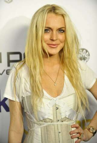 WEST HOLLYWOOD, CA - NOVEMBER 12: Lindsay Lohan poses for a picture at Jermaine Dupri and Pascal Mouawad's Nu Pop Movement launch party held at Kitson Men's on November 12, 2009 in West Hollywood, California. (Photo by Toby Canham/Getty Images) *** Local Caption *** Lindsay Lohan Photo: Toby Canham, Getty Images / 2009 Getty Images