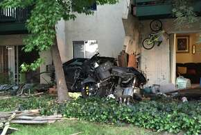 A suspected drunken driver crashed into this apartment complex in Livermore, killing a woman and an infant, police say.
