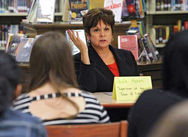 "Colonie Supervisor Paula Mahan speaks on a panel with other prominent woman leaders in the community at the annual ""Women in Leadership"" event put on by Girls Take Charge at Shaker Junior High School on Friday, April 24, 2015 in Colonie, N.Y. Mahan announced her campaign to seek a fifth term as town supervisor on May 3, 2015.  (Lori Van Buren / Times Union) Photo: Lori Van Buren / 00031547A"