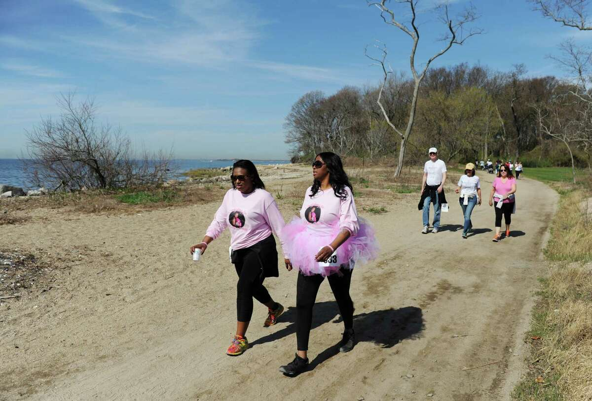 Saipin Ashton, left, of Norwalk, and Stephanie Hall, of Bridgeport, wear pink