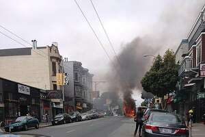 Tour bus bursts into flames on Haight Street - Photo