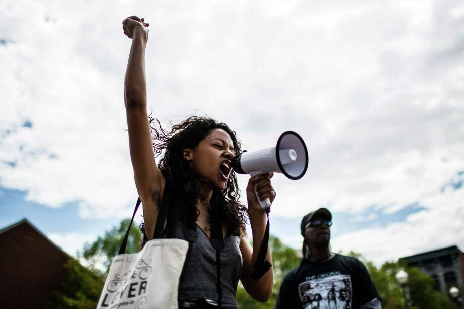 Angela Kirkland leads a chant during a Baltimore solidarity rally, Saturday, May 2, 2015 in Harrisburg, Pa.Latest from AP: Baltimore lifts curfew after days of tension Photo: James Robinson, AP / PennLive.com