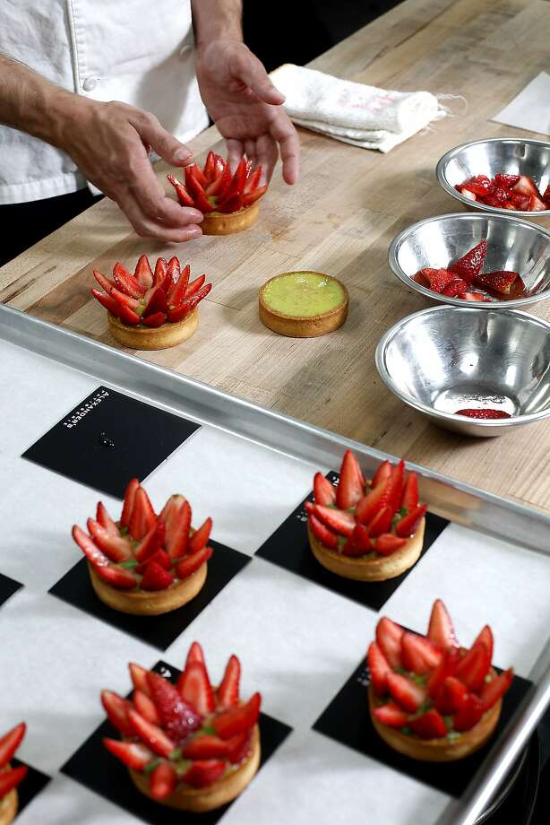 Executive pastry chef Dries Delanghe makes strawberry tarts with basil citrus cream at Alexander's Patisserie. Photo: Sarah Rice, Special To The Chronicle