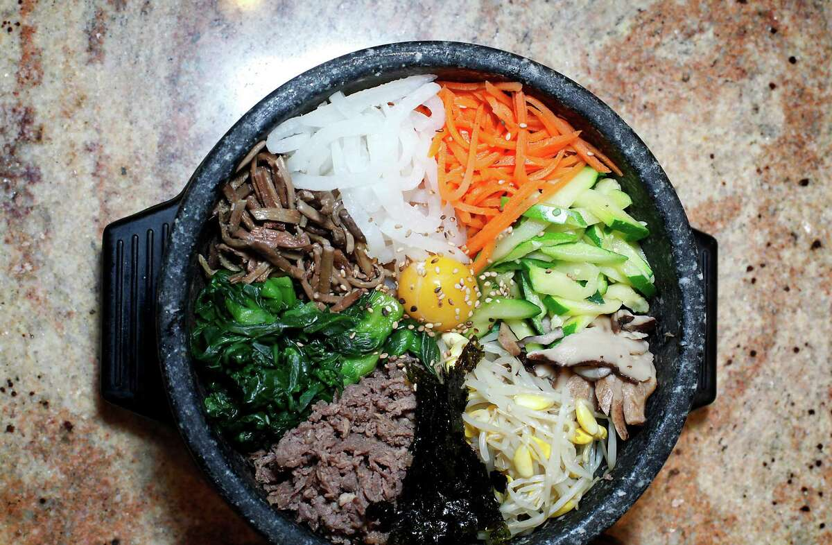 The dolsat bibimbap at Jang Su Jang, where you can grill marinated meat on a vented cooktop at your table.