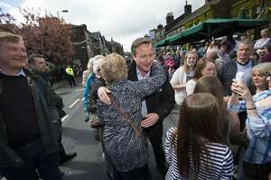 Cameron, rivals stump for votes before British election - Photo