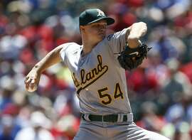 Oakland Athletics starting pitcher Sonny Gray (54) delivers to the Texas Rangers during the first inning of a baseball game, Sunday, May 3, 2015, in Arlington, Texas. (AP Photo/Jim Cowsert)