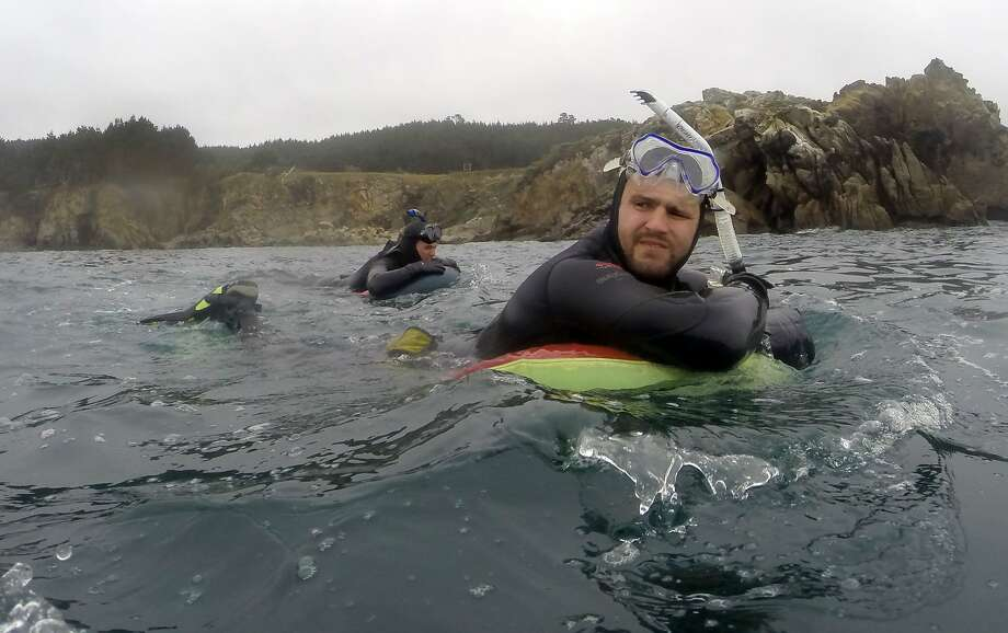 DCIM\116GOPROFirst-time abalone divers Sebastian Erggelet, right, and Allan Roan kick out to a dive spot at Salt Point State Park in Sonoma County on Saturday, May 2, 2015. Photo: Mathew Sumner, Special To The Chronicle