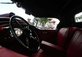 A couple admires a 1929 Blackhawk Stutz at the 20th annual Keels and Wheels Concours d'Elegance at the Lakewood Yacht Club Sunday, May 3, 2015, in Seabrook.