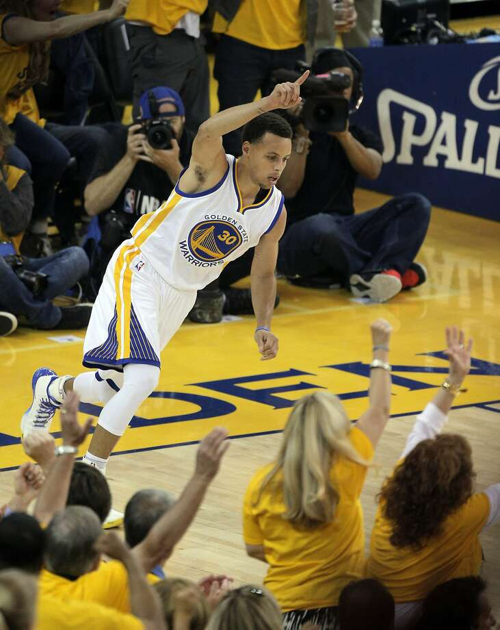 Stephen Curry (30) celebrates a three point shot during the first half. The Golden State Warriors played the Memphis Grizzlies at Oracle Arena in Oakland, Calif., in Game 1 of the Western Conference Semifinals on Sunday, May 3, 2015. Photo: Carlos Avila Gonzalez, The Chronicle