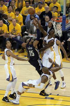 Jumble of players under the basket as Vince Carter (15) tries to put in a shot during the first half. The Golden State Warriors played the Memphis Grizzlies at Oracle Arena in Oakland, Calif., in Game 1 of the Western Conference Semifinals on Sunday, May 3, 2015.