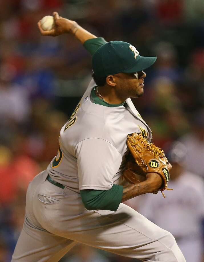 ARLINGTON, TX - MAY 01:  Fernando Abad #56 of the Oakland Athletics throws against the Texas Rangers in the seventh inning at Globe Life Park in Arlington on May 1, 2015 in Arlington, Texas.  (Photo by Ronald Martinez/Getty Images) Photo: Ronald Martinez, Getty Images