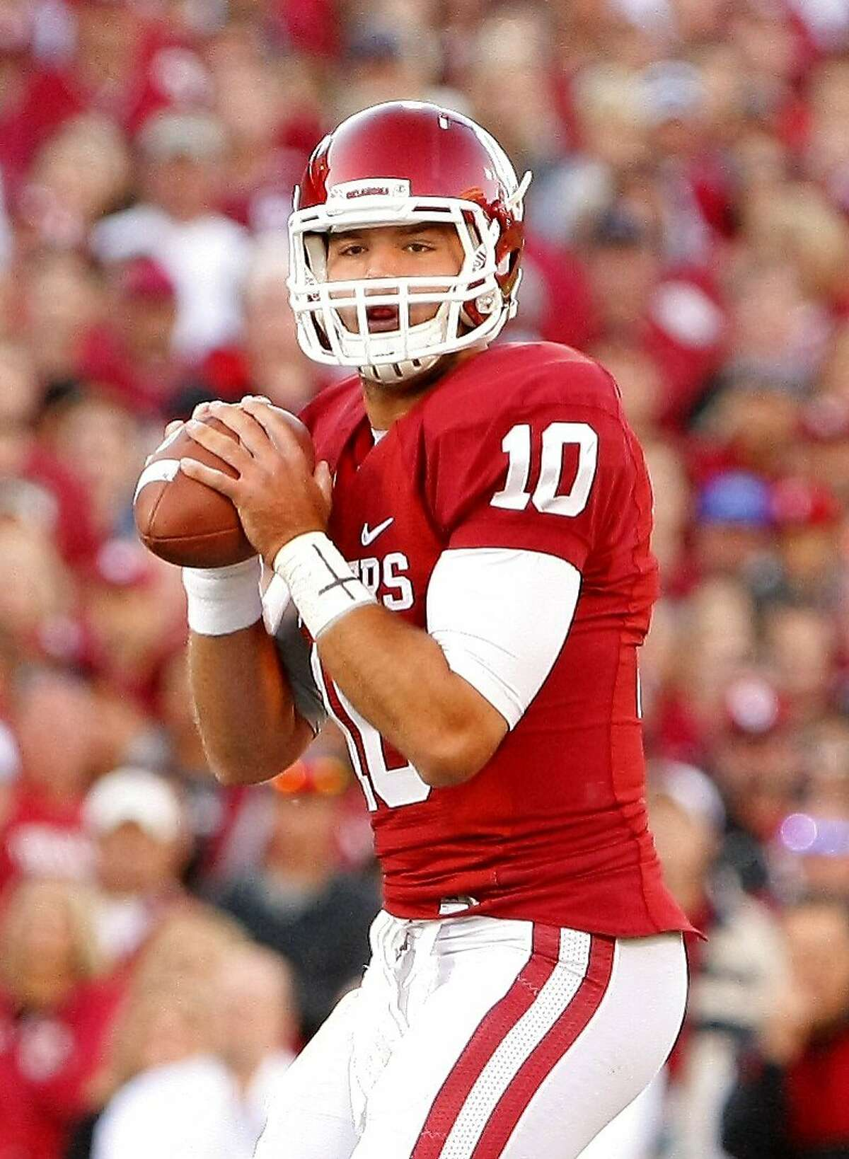 Oklahoma quarterback Blake Bell (10) throws a warm up pass before the start of an NCAA college football game against TCU on Saturday, Oct. 5, 2013, in Norman, Okla. (AP Photo/Alonzo Adams)