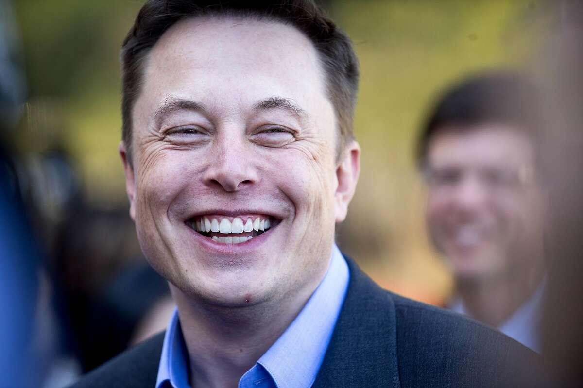 Tesla CEO Elon Musk speaks with members of the media at Tesla's headquarters in Palo Alto, Calif., Thursday, April 30, 2015. (AP Photo/Noah Berger)
