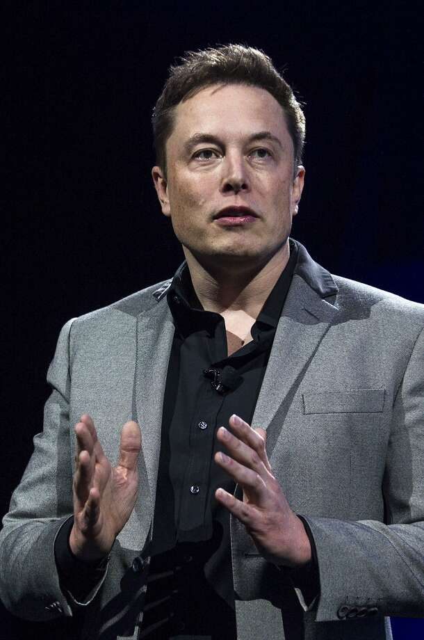 Elon Musk, CEO of Tesla Motors Inc., unveils the company's newest products, Powerwall and Powerpack in Hawthorne, Calif., Thursday, April 30, 2015.  (AP Photo/Ringo H.W. Chiu) Photo: Ringo H.W. Chiu, Associated Press