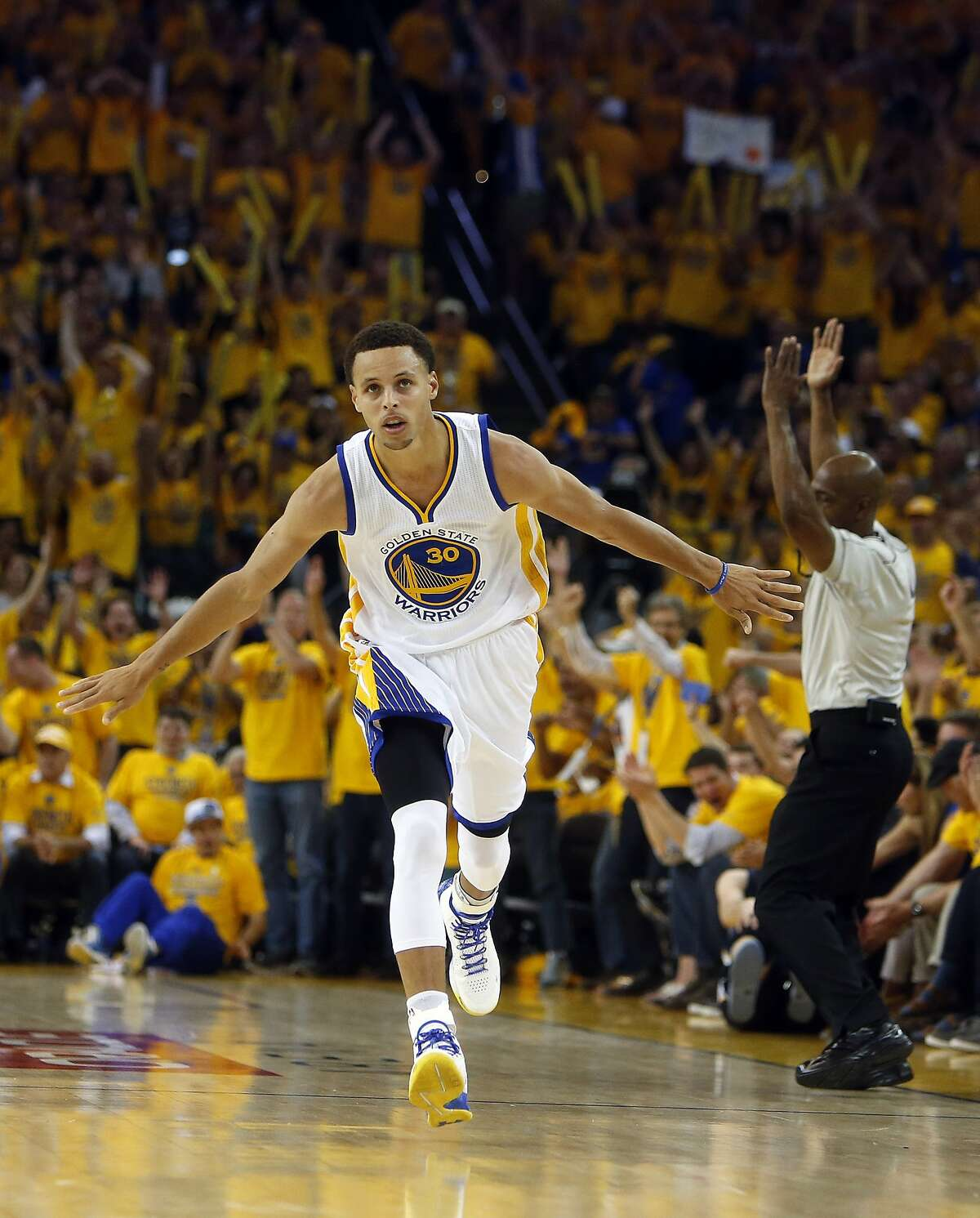 Golden State Warriors' Stephen Curry celebrates a 3-pointer in 3rd quarter of Warriors' 101-86 win over Memphis Grizzlies during Game 1 of NBA Playoffs' Western Conference Semifinals in Oakland, Calif., on Sunday, May 3, 2015.