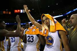 Golden State Warriors' Stephen Curry celebrates after Warriors' 101-86 win over Memphis Grizzlies during Game 1 of NBA Playoffs' Western Conference Semifinals in Oakland, Calif., on Sunday, May 3, 2015.