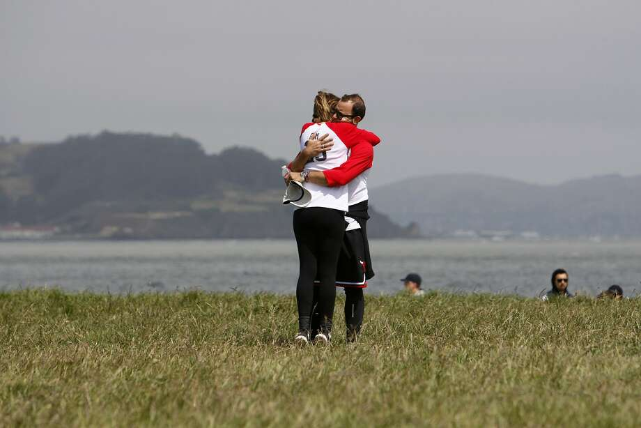 Marc Stiglitz and his wife, Kim Stiglitz, of San Francisco embrace near the finish of the 10th Annual AVM Awareness Walk hosted by the Aneurysm and AVM Foundation at Crissy Field in San Francisco on Sunday, May 4, 2015. Marc Stiglitz (44) suffered a congenital AVM rupture in 2011, and is still recovering. AVM is an arterial brain condition that can cause devastating hemorrhages and other symptoms. Photo: Terray Sylvester, The Chronicle