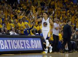 Golden State Warriors' Stephen Curry reacts to his 3-pointer in 4th quarter against Memphis Grizzlies during Warriors' 101-86 win Game 1 of NBA Playoffs' Western Conference Semifinals in Oakland, Calif., on Sunday, May 3, 2015.