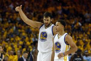 Golden State Warriors' Andrew Bogut and Stephen Curry confer in 3rd quarter against Memphis Grizzlies during Warriors' 101-86 win Game 1 of NBA Playoffs' Western Conference Semifinals in Oakland, Calif., on Sunday, May 3, 2015.