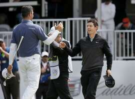 Rory McIlroy (right) embraced Gary Woodland after his victory was complete on the 16th hole of match play Sunday May 3, 2015. Rory McIlroy defeated Gary Woodland to capture the 2015 PGA Tour's Match Play Championship at Harding Park in San Francisco, Calif.