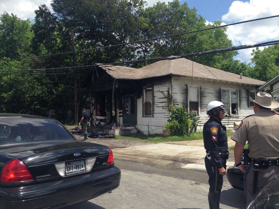 A Texas trooper, far right, was driving down the street when he saw flames coming from a duplex in the 5200 block of South Presa at about 10:30 a.m.