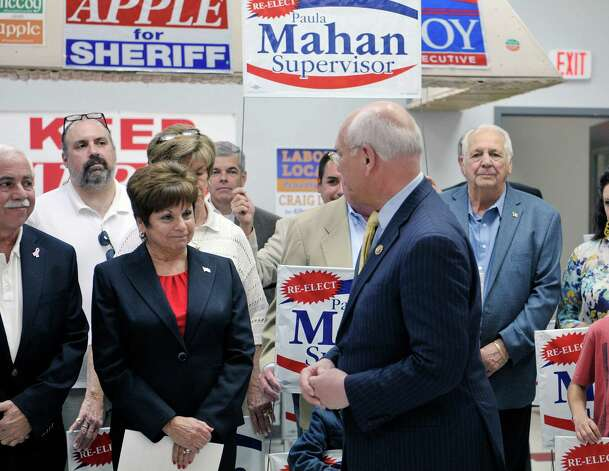 Colonie Town Supervisor Paula Mahan, left, listens as Congressman Paul Tonko talks about her during a campaign event on Sunday, May 3, 2015, in Colonie, N.Y.  Mahan held the event to kick off her campaign for a fifth two-year term.   (Paul Buckowski / Times Union) Photo: PAUL BUCKOWSKI / 00031685A