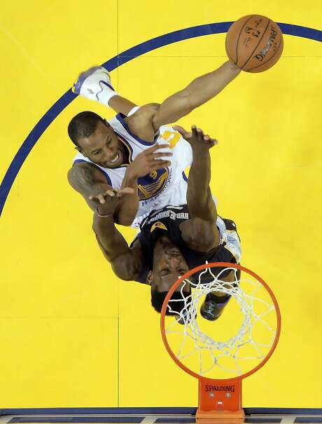 Andre Iguodala (9) puts in a shot defended by Jeff Green (32) during the first half. The Golden State Warriors played the Memphis Grizzlies at Oracle Arena in Oakland, Calif., in Game 1 of the Western Conference Semifinals on Sunday, May 3, 2015. Photo: Carlos Avila Gonzalez, The Chronicle