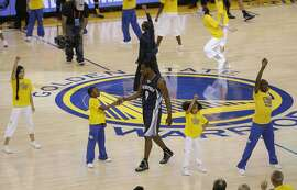 Memphis Grizzlies forward Tony Allen (9) greets a dancer during a timeout during the first half of Game 1 in a second-round NBA playoff basketball series against the Golden State Warriors in Oakland, Calif., Sunday, May 3, 2015. (AP Photo/Jeff Chiu)
