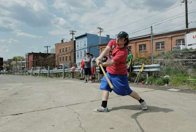 Michael Nagle of Troy on team DeFazio takes a swing at the ball during the 7th annual Stick it to Hunger stick ball tournament on Sunday, May 3, 2015, in Troy, N.Y.  The event raises money and food for area food pantries.  Organizers said that the event has raised over $60,000 since it started and that they hope to raise $15,000 this year.  (Paul Buckowski / Times Union) Photo: PAUL BUCKOWSKI / 00031670A