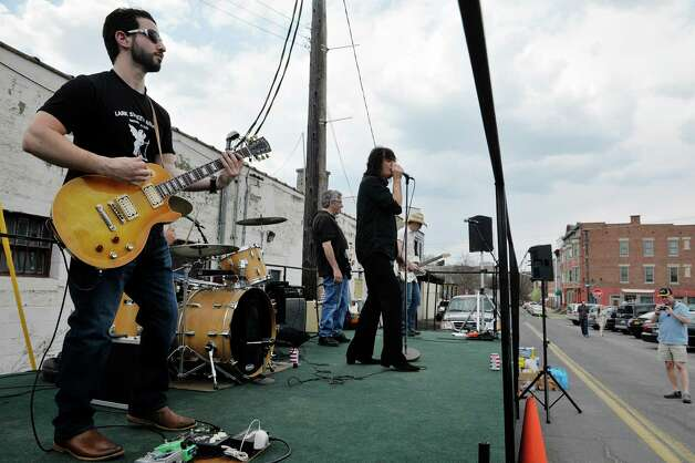 Members of the band Blue Hand Luke perform at the 7th annual Stick it to Hunger stick ball tournament on Sunday, May 3, 2015, in Troy, N.Y.  The event raises money and food for area food pantries.  Organizers said that the event has raised over $60,000 since it started and that they hope to raise $15,000 this year.  (Paul Buckowski / Times Union) Photo: PAUL BUCKOWSKI / 00031670A