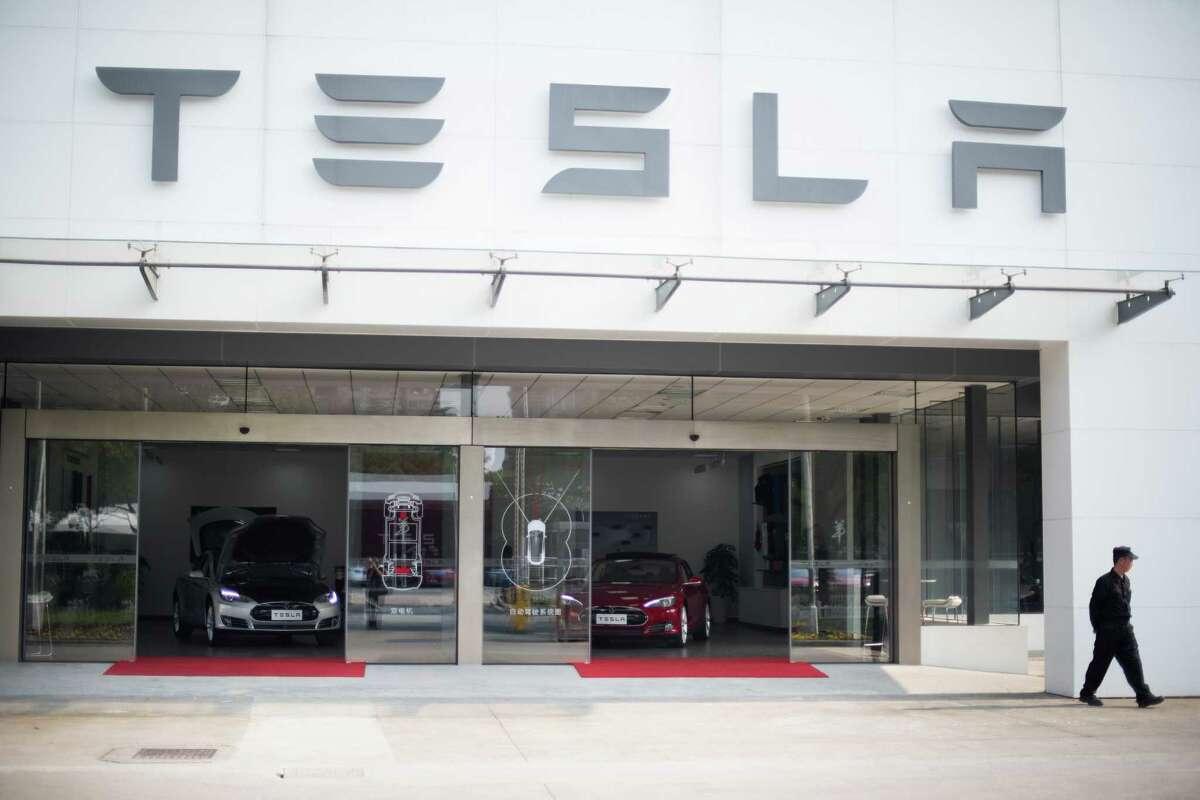 Tesla Motors has faced stiff competition in Texas as it tries to wrangle permission to sell its electric cars, here on display in Shanghai, directly to customers. Texas law requires new cars to be sold through a dealer.