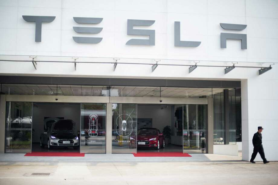 Tesla Motors has faced stiff competition in Texas as it tries to wrangle permission to sell its electric cars, here on display in Shanghai, directly to customers. Texas law requires new cars to be sold through a dealer. Photo: JOHANNES EISELE, Staff / AFP