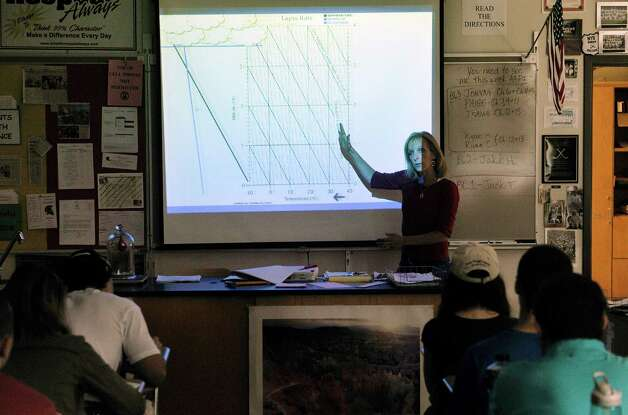 Burnt Hills-Ballston Lake High School science teacher Melissa Thomas teachers her students weather variables  during class on Thursday, April 30, 2015, in Burnt Hills, N.Y.    (Paul Buckowski / Times Union) Photo: PAUL BUCKOWSKI / 00031629A
