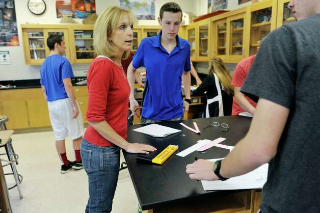 Burnt Hills-Ballston Lake High School science teacher Melissa Thomas works with her students during class on Thursday, April 30, 2015, in Burnt Hills, N.Y.    (Paul Buckowski / Times Union) Photo: PAUL BUCKOWSKI / 00031629A