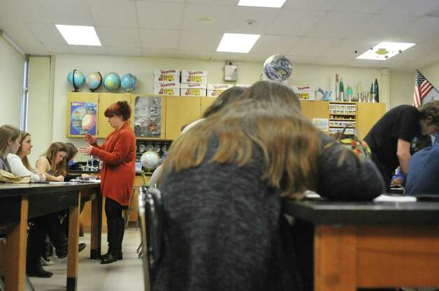 Saratoga High School Earth Science teacher, Charlotte Naples, works with students during class on Monday, April 27, 2015, in Saratoga Springs, N.Y.  Naples is in the statewide Master Teacher program.   (Paul Buckowski / Times Union) Photo: PAUL BUCKOWSKI / 00031600A