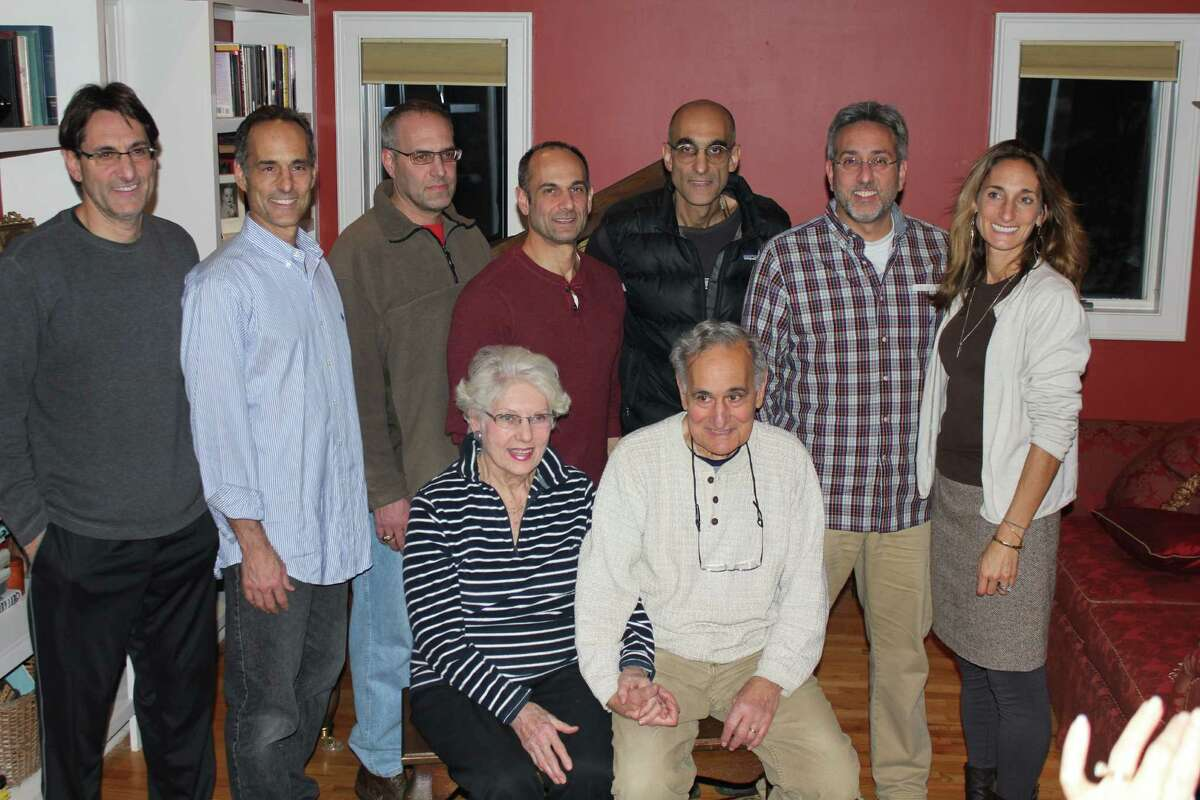 Dr. Tom Catena (back row, third from right) with his parents, Nancy and Gene, and siblings at Thanksgiving.