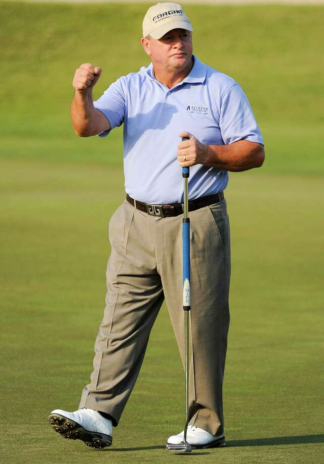 Ian Woosnam wears a look of relief at sinking the winning putt on the first playoff hole, accomplishing his goal of seeing the playoff end quickly with his back acting up and a flight to catch. Photo: Eric Christian Smith, For The Chronicle / 2015 Eric Christian Smith
