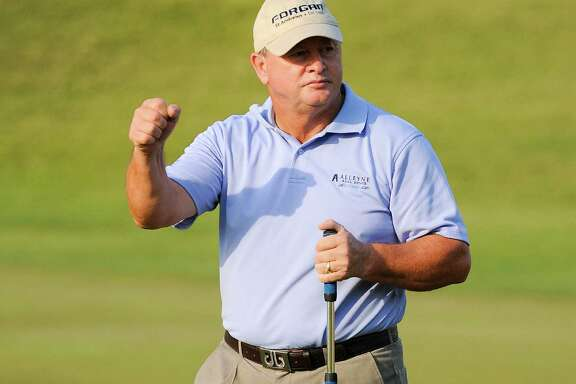 Ian Woosnam wears a look of relief at sinking the winning putt on the first playoff hole, accomplishing his goal of seeing the playoff end quickly with his back acting up and a flight to catch.